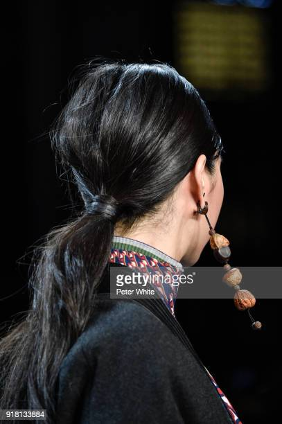 A model jewelry detail walks the runway at the Vivienne Tam show during New York Fashion Week at Gallery I at Spring Studios on February 13 2018 in...