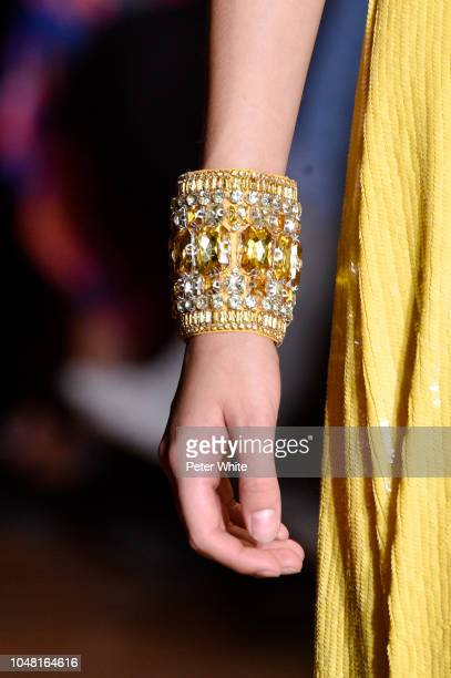 A model jewelry detail walks the runway during the Andrew GN show as part of the Paris Fashion Week Womenswear Spring/Summer 2019 on September 28...