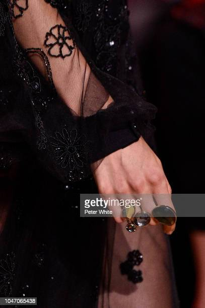 A model jewelry detail walks the runway during the Elie Saab show as part of the Paris Fashion Week Womenswear Spring/Summer 2019 on September 29...