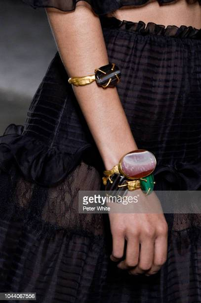 A model jewelry detail walks the runway during the Giambattista Valli show as part of the Paris Fashion Week Womenswear Spring/Summer 2019 on October...