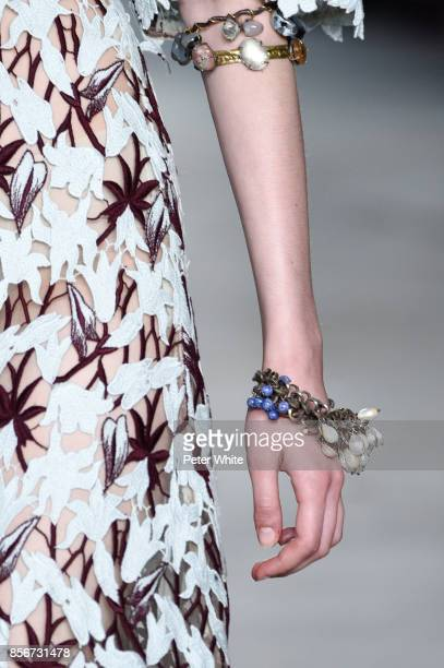 A model jewelry detail walks the runway during the Giambattista Valli Paris show as part of the Paris Fashion Week Womenswear Spring/Summer 2018 on...