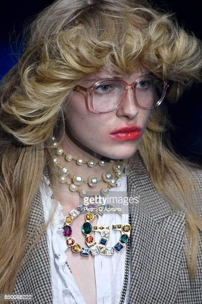 A model jewelry details walks the runway at the Gucci show during Milan Fashion Week Spring/Summer 2018 on September 20 2017 in Milan Italy