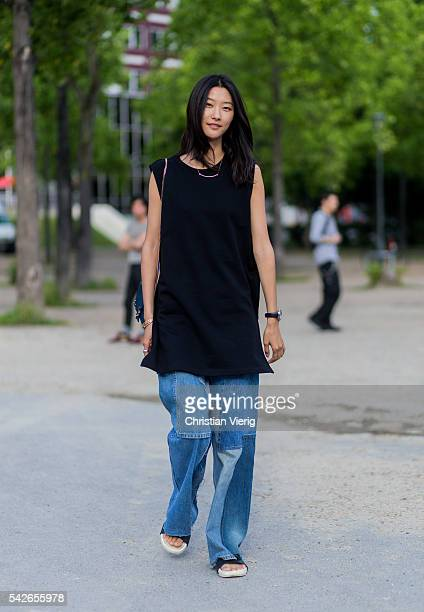 Model Ji Hye Park outside Dries van Noten during the Paris Fashion Week Menswear Spring/Summer 2017 on June 23 2016 in Paris France