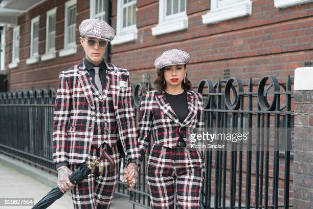 Model Jimmy Q wears all Joshua Kane with Linda Farrow sunglasses with Fashion stylist Jet Luna wearing all Joshua Kane on day 3 of London Collections...