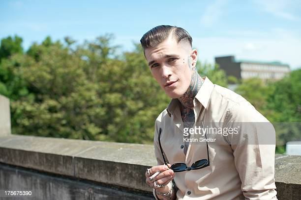Model Jimmy Q wears vintage shirt RayBan sunglasses The Great Frog jewellery and a Rolex watch on day 3 of Graduate Fashion week on June 04 2013 in...
