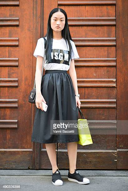 Model Jing Wen poses after the MSGM show during the Milan Fashion Week Spring/Summer 16 on September 27 2015 in Milan Italy