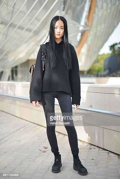 Model Jing Wen poses wearing Adidas shoes after the Louis Vuitton show at the Fondation Louis Vuitton during Paris Fashion Week SS16 on October 7...