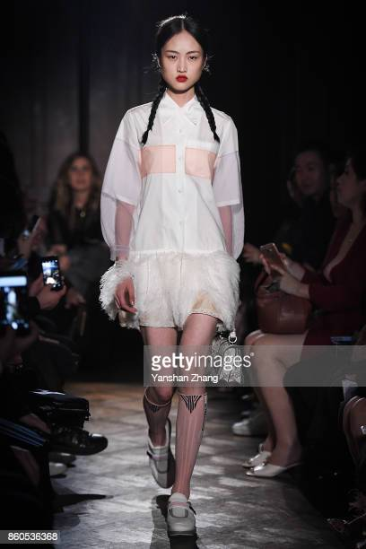 Model Jing Wen walks the runway during Prada 2018 Resort Fashion Show at Prada Rong Zhai on October 12 2017 in Shanghai China