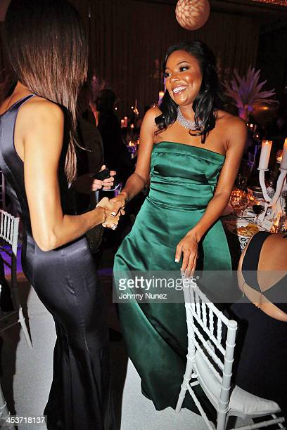 Model Joan Smalls and actress Gabrielle Union attend the 2013 Alvin Ailey American Dance Theater's opening night benefit gala at New York City Center...