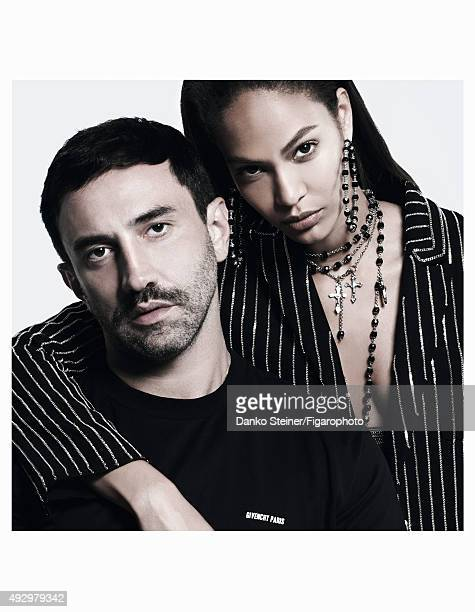 Model Joan Smalls and fashion designer Riccardo Tisci pose at a fashion shoot for Madame Figaro on June 27 2015 in Paris France Joan Jacket earrings...