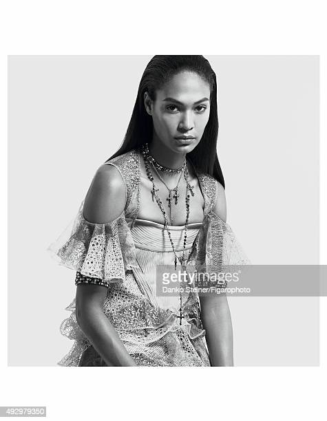 Model Joan Smalls poses at a fashion shoot for Madame Figaro on June 27, 2015 in Paris, France. Corset, dress, necklaces, boots . Make-up by Estée...