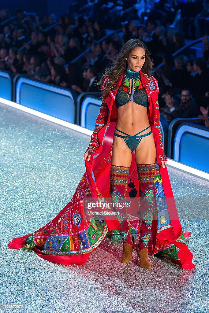 Model Joan Smalls walks the runway during the 2016 Victoria's Secret Fashion Show at Le Grand Palais in Paris on November 30, 2016 in Paris, France.