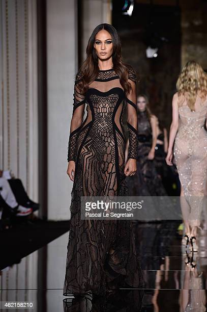 Model Joan Smallsl walks the runway during the Versace show as part of Paris Fashion Week Haute Couture Spring/Summer 2015 on January 25 2015 in...