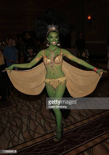 Model Joanie Brosas dressed as an Orion showgirl character from the Star Trek franchise attends the 12th annual Star Trek convention at the Rio Hotel...
