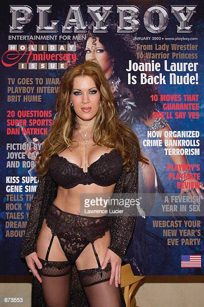 Model Joanie Laurer formerly known as WWF wrestler Chyna poses at a preview of the Exotic Erotic Ball at Virgin Megastore November 26 2001 in New...
