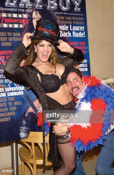 Model Joanie Laurer formerly known as WWF wrestler Chyna poses with Perry Mann cofounder of the Exotic Erotic Ball at a preview of the Ball at Virgin...