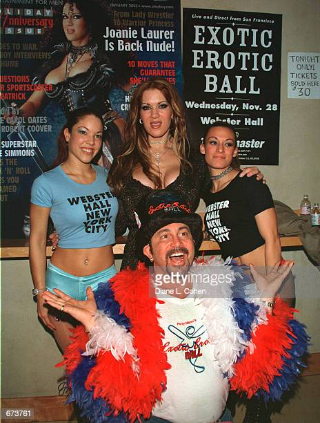 Model Joanie Laurer formerly known as WWF wrestler Chyna poses with the cofounder of the Exotic Erotic Ball Perry Mann and two Webster Hall Girls at...