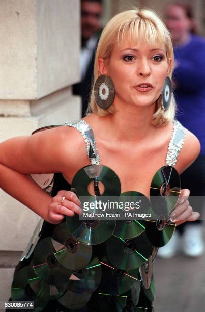 Model Joanne Guest poses for the media in a dress made entirely out of DVD during a photocall in London to officially launch the DVD video at BAFTA *...