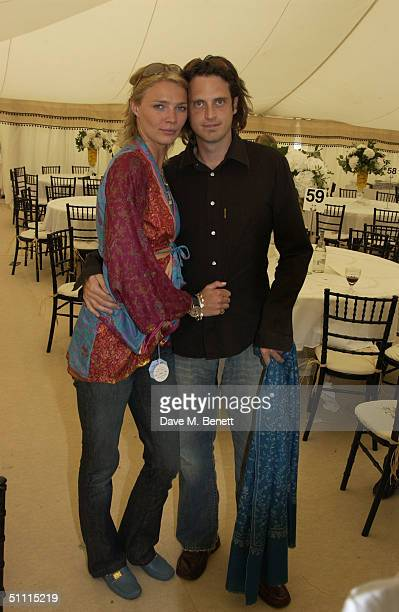 Model Jodie Kidd and internet entrepreneur partner Aidan Butler attend the Cartier International Day held at Guards Polo Club Windsor Great Park on...