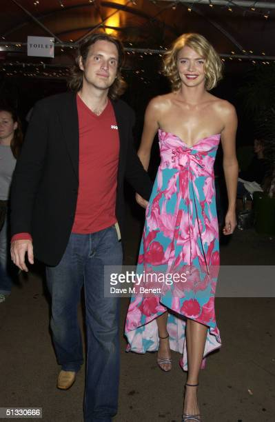 Model Jodie Kidd and partner Aidan Butler attend the afterparty following the 'Clothesline' Gala Fashion Show at Aura on September 20 2004 in London...