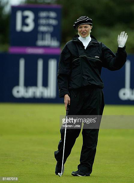 Model Jodie Kidd gestures on the 13th hole after hitting her ball at the crowd during the third round of the Dunhill Links pictured at Kingsbarns...