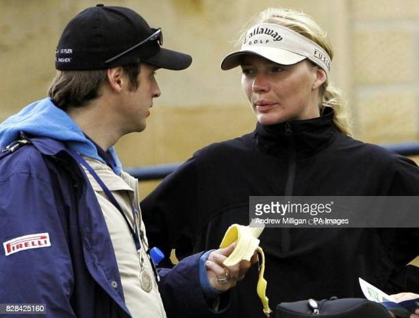 Model Jodie Kidd watches her husband Aidan Butler eat a banana during the second round of the Dunhill Links Championships at St Andrews Golf Course...