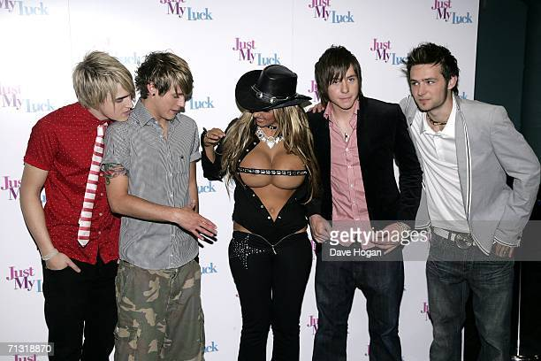 Model Jodie Marsh and McFly members Tom Fletcher Dougie Poynter Danny Jones and Harry Judd arrive at the UK Charity Premiere of Just My Luck at Vue...