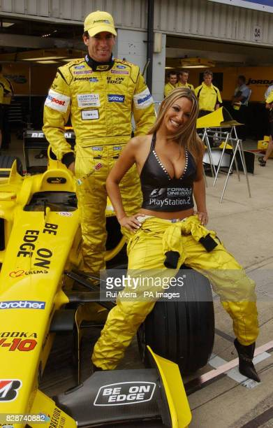 Model Jodie Marsh poses with Jordan driver Ralph Firman at the launch of Sony's new Play Station 2 game Formula One 2003 at the British Grand Prix at...