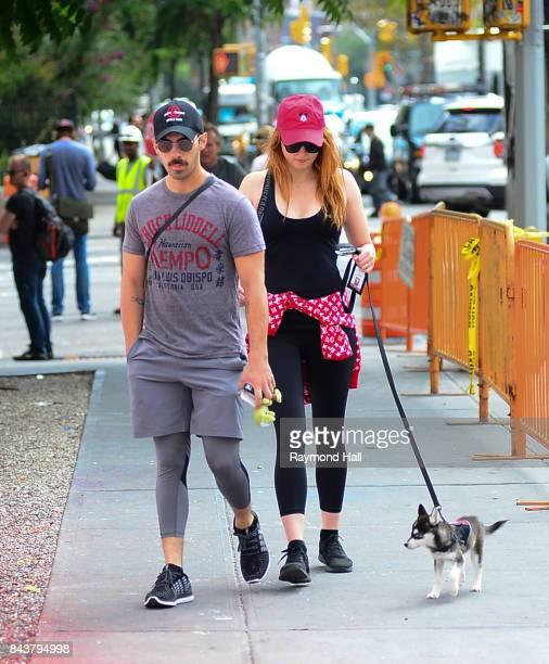 Model Joe Jonas and Sophie Turner walk their dog in soho on September 7 2017 in New York City