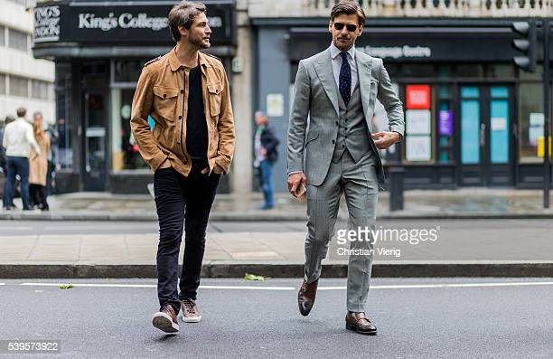 Model Johannes Huebl wearing a grey suit, vest and tie and Robert Konjic outside Christopher Raeburn during The London Collections Men SS17 on June...