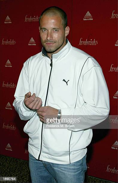 Model Johnny Musler attends the Frederick's of Hollywood Fall 2003 fashion show and auction at Smashbox Studios April 1 2003 in Los Angeles California