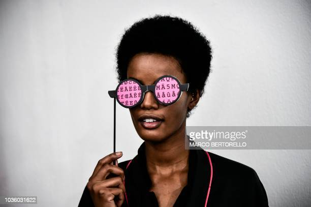 TOPSHOT A model jokes backstage before presenting creations by Annakiki during the Women's Spring/Summer 2019 fashion shows in Milan on September 19...