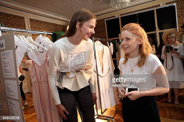 A model jokes with fashion designer Malaika Raiss backstage ahead of the Malaikaraiss show during the MercedesBenz Fashion Week Berlin Spring/Summer...