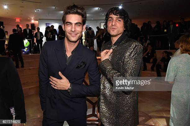 Model Jon Kortajarena wearing a Bulgari watch and ring and photographer Sebastian Faena attend An Evening of Music Art Mischief and Performance to...
