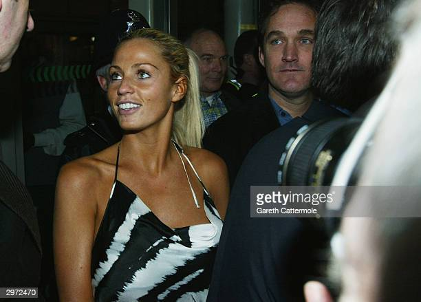 Model Jordan arrives at Heathrow Airport after competing in the reality TV show I'm A Celebrity Get Me Out Of Here on February 12 2004 in London
