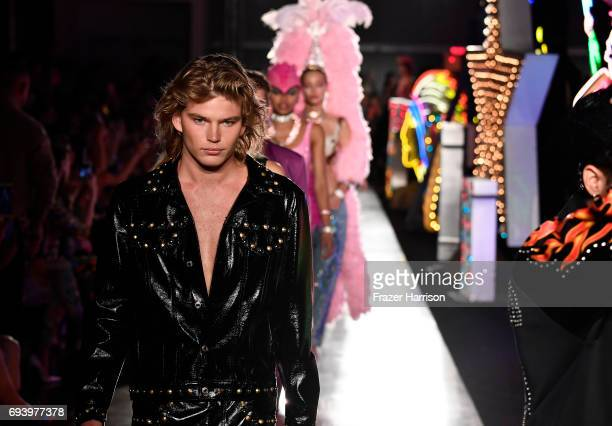 Model Jordan Barrett walk the runway at Moschino Spring/Summer 18 Menswear and Women's Resort Collection at Milk Studios on June 8 2017 in Hollywood...