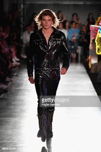 Model Jordan Barrett walks the runway at Moschino Spring/Summer 18 Menswear and Women's Resort Collection at Milk Studios on June 8 2017 in Hollywood...