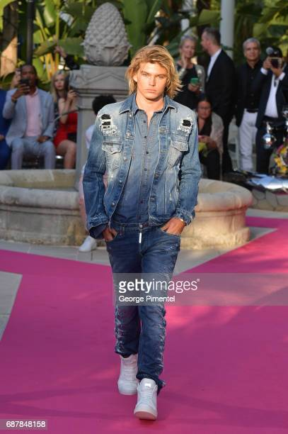 Model Jordan Barrett wearing Philipp Plein walk the runway at the Philipp Plein Cruise Show 2018 during the 70th annual Cannes Film Festival at on...
