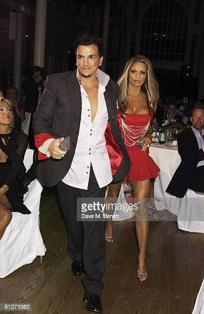 Model Jordan with partner singer Peter Andre pose in the pressroom at the GQ Men Of The Year Awards at the Royal Opera House on September 7 2004 in...