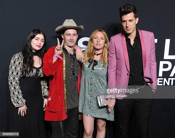 Model Josephine de La Baume and recording artist Mark Ronson attend the Saint Laurent show at The Hollywood Palladium on February 10 2016 in Los...