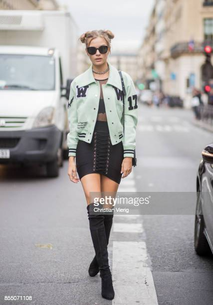Model Josephine Skriver with pigtails wearing a mint leather jacket overknee boots Chanel bag sheer black dress is seen outside Balmain during Paris...