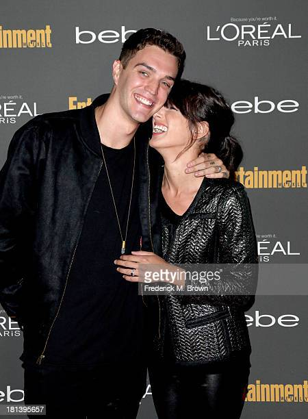 Model Josh Beech and actress Shenae Grimes arrive at Entertainment Weekly's PreEmmy Party at Fig Olive Melrose Place on September 20 2013 in West...