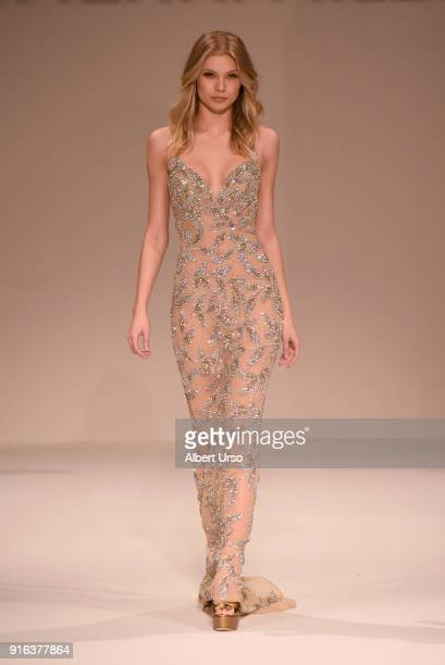 Model Josie Canseco walks the runway during the NYFW Sherri Hill Runway Show on February 9 2018 in New York City