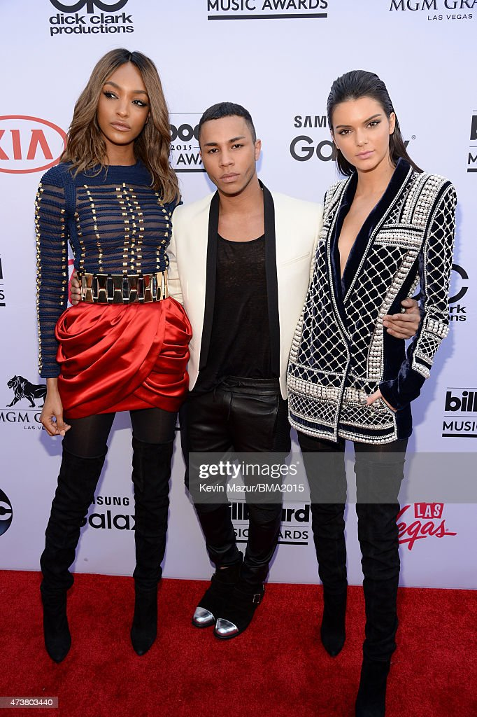Model Jourdan Dunn, fashion designer Olivier Rousteing, and TV personality Kendall Jenner, all wearing Balmain x H&M, attend the 2015 Billboard Music Awards at MGM Grand Garden Arena on May 17, 2015 in Las Vegas, Nevada.