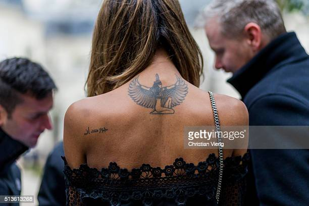 Model Jourdan Dunn from the back showing her tattoos outside Balmain during the Paris Fashion Week Womenswear Fall/Winter 2016/2017 on March 3 2016...