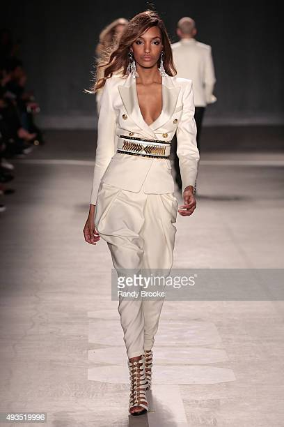 Model Jourdan Dunn walks the runway at the BALMAIN X HM Collection Launch at 23 Wall Street on October 20 2015 in New York City