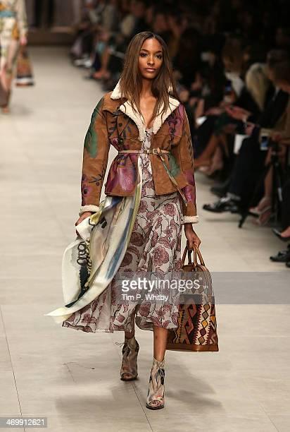 Model Jourdan Dunn walks the runway at the Burberry Prorsum show at London Fashion Week AW14 at Perks Fields Kensington Gardens on February 17 2014...