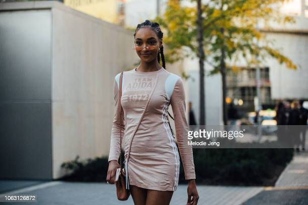 Model Jourdan Dunn wears pink skinny sunglasses and a pink Adidas dress after the Burberry show during London Fashion Week September 2018 on...