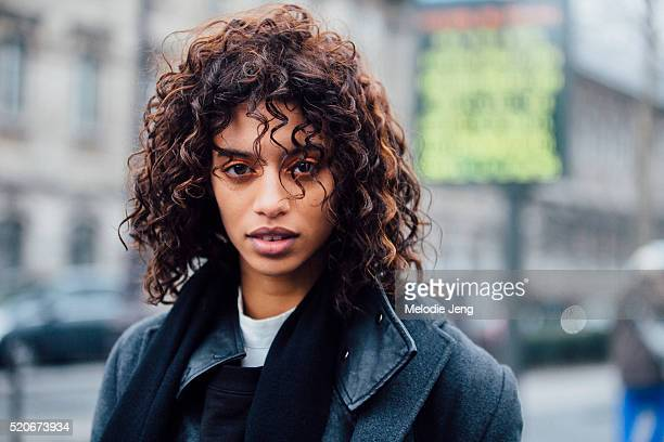 Model Jourdana Phillips exits the Each x Other show at Le Trianon sparkly copper eye makeup by Carole Colombani and windswept curly hair by Laurent...