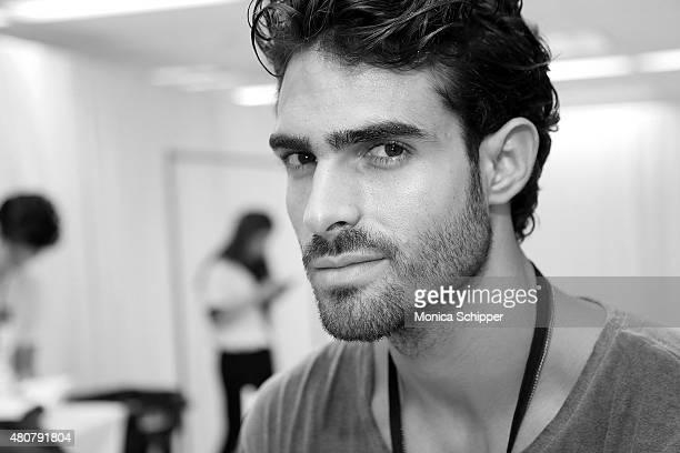 Model Juan Betancourt prepares backstage at the Thorsun Swim Presentation during New York Fashion Week Men's S/S 2016 at Skylight Clarkson Sq on July...